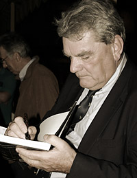photo: Irving signing a book.