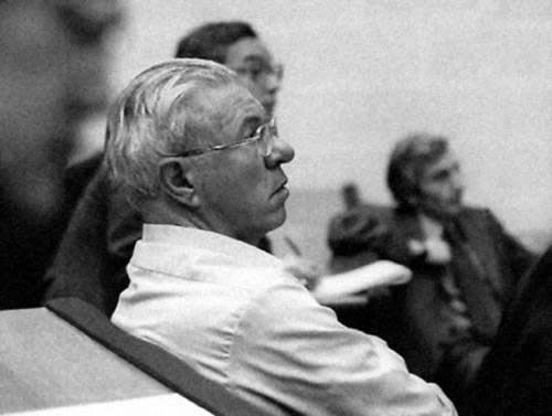 Fred Hoyle in the New Cavendish Lecture Hall, listening to a speaker, 1981.