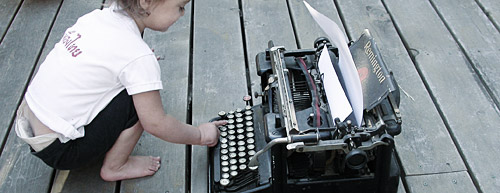 human with a typewriter