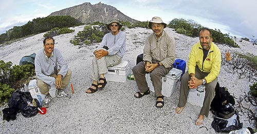 The expedition to retrace Darwin's footsteps in the Galápagos camps on the same beach where Darwin camped in September of 1835. Left-right: Frank Sulloway, Chuck Lemme, Phil Pack, and Michael Shermer. The volcanic peak in the background is Cerro Brujo.