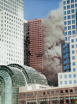 Figure 3. WTC 7 seen from the Southwest side, showing the<br /> true extent of fire and structural damage