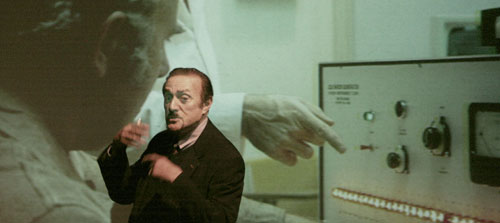 Philip Zimbardo, with slide of shock machine experiment