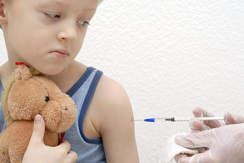 photo of boy receiving injection