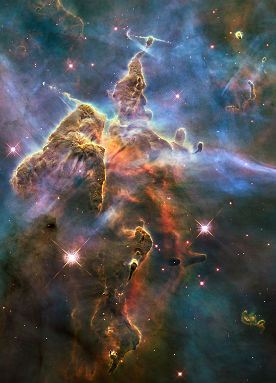 A a mountain of dust and gas rising in the Carina Nebula. Credit: NASA, ESA, and M. Livio and the Hubble 20th Anniversary Team (STScI)