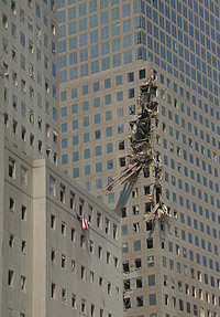 Beam from the World Trade Center lodged in a nearby building (photo by Michael Rieger, FEMA News. As works of the U.S. federal government, all FEMA images are in the public domain.