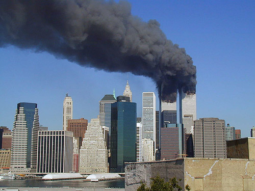 Plumes of smoke billow from the World Trade Center towers, September 11 (photo by Flickr user Michael Foran at http://www.flickr.com/photos/pixorama/ used under Creative Commons license Attribution 2.0 Generic