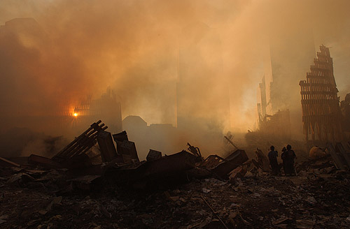 Sun streams over WTC wreckage (Photo by Andrea Booher/FEMA News Photo, taken on 09-13-2001. As works of the U.S. federal government, all FEMA images are in the public domain.)