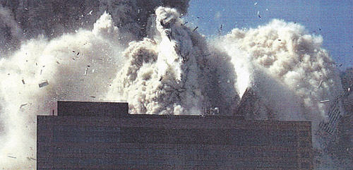 WTC7 engulfed in debris (photo from NIST Report Executive Summary 2008)