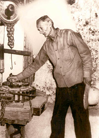 Edward Leedskalnin with some of his extensive, homemade equipment with which he quarried and fabricated the Coral Castle.