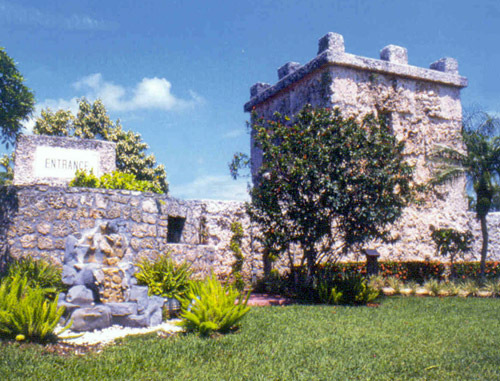 A view of the present front entrance to the Coral Castle showing sections of the curtain wall and the turret that is composed of two rooms, a lower one for tools and storage and an upper, living room for Ed Leedskalnin.
