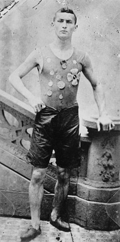Not yet Houdini, Ehrich Weiss poses wearing medals he won as a member of the Pastime Athletic Club track team in New York (c. 1890). McManus-Young Collection (Library of Congress)