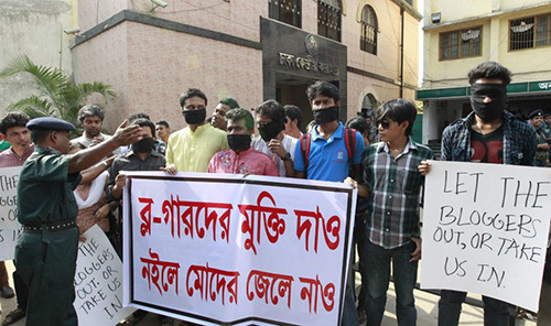 The teachers and students and online activists gathered in front of Dhaka Central Jail holding placards: 'Either release the arrested bloggers from jail or put us into it.'
