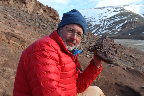 Neil Shubin with Tiktaalik Fossil. (Courtesy of Tangled Bank Studios, LLC)