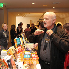 John Rael (left) at the book table with author David Brin (right)
