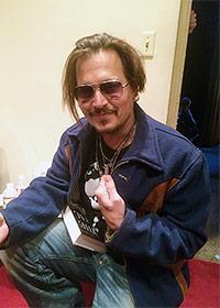 Johhny Depp sporting a Skeptic lapel pin