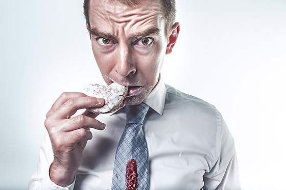 Man eating donut (https://www.pexels.com/photo/food-man-person-eating-2261/). Images used under Creative Commons Zero license. (https://creativecommons.org/choose/zero/)