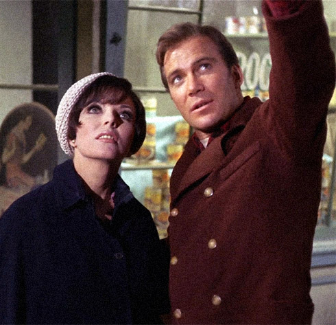 Joan Collins as Edith Keeler (left) and William Shatner as Captain James T. Kirk (right), in year 1930. Film still from the episode 'The City on the Edge of Forever.' (Credit: CBS)