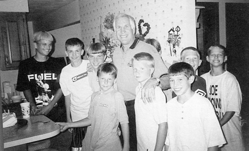 Jerry Sandusky around 1999 with Second Mile kids, most of whom later claimed that he abused them and received millions of dollars in settlements.