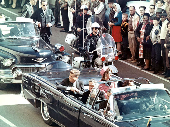 President John F. Kennedy in the limousine in Dallas, Texas, on Main Street, minutes before the assassination.