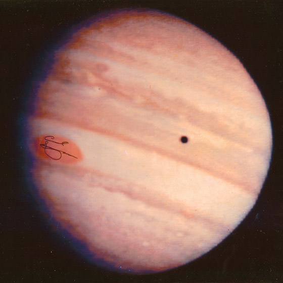 Jupiters red spot signed by Carl Sagan