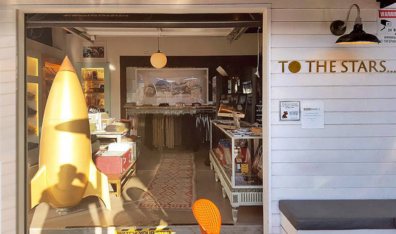 Figure 1: To The Stars flagship retail store in Encinitas, CA sells hats, coffee cups, T-shirts, and books by Tom DeLonge.
