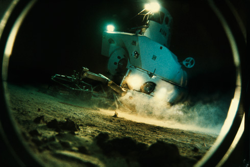 View through a porthole of the submersible Alvin exploring sea floor. (National Geographic/Emory Kristof)
