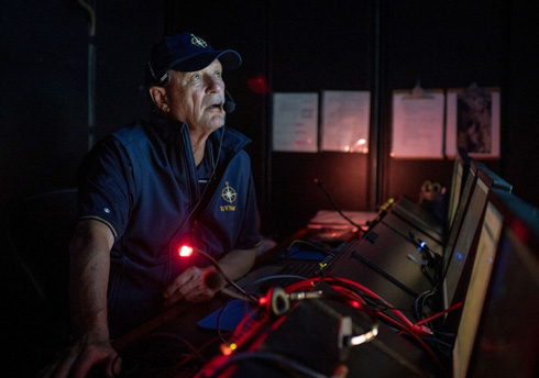 Robert Ballard in control room of the E/V Nautilus while on expedition in the South Pacific. (National Geographic/Gabriel Scarlett)