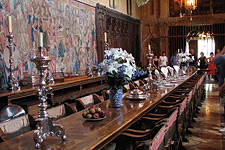 The Hearst Castle dining room, filled floor-to-ceiling with rare museum-quality furnishings, (and used as a model for the dinning hall in the Harry Potter films), also featuring humble ketchup and mustard bottles on the table among the sumptuous settings.