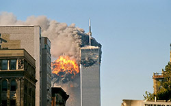 UA Flight 175 hits WTC south tower 9-11 (photo by Flickr user TheMachineStops at http://www.flickr.com/photos/themachinestops) used under Creative Commons license Attribution-ShareAlike 2.0 Generic