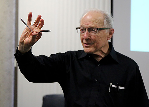 Ray Hyman demonstrates Uri Gueller's spoon bending feats at CFI lecture. June 17, 2012 Costa Mesa, CA. Photo by Sgerbic (own work) [CC BY-SA 3.0], via Wikimedia Commons