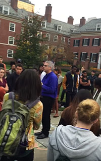 Yale college master Nicholas Christakis (in blue shirt) is verbally assaulted by a student who accused him of not doing enough to censor the wearing of Halloween costumes that could be seen as offensive. 'Who the fuck hired you?' the girl with the backpack screamed at the professor.
