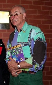 Karl Kruszelnicki holding a copy of his book, Sensational Moments in Science, at Sydney Uni Live! (the University of Sydney's open day) in August 2006. Image by Enoch Lau, via Wikimedia Commons. Used under  Creative Commons Attribution-Share Alike 3.0 Unported license.