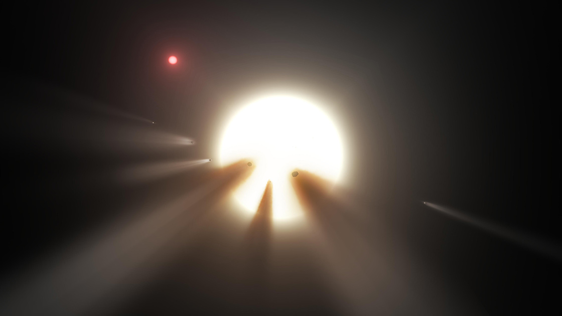 An artist's concept depicts an orbiting swarm of dusty comet fragments as a possible explanation for the unusual light signal of KIC 8462852. (by NASA/JPL-Caltech [Public domain], via Wikimedia Commons)