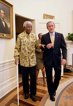 Former President Nelson Mandela of South Africa meets with US President George W. Bush in the Oval Office in 2005. And yet, according to some people's memories, Mandela died two decades earlier. (White House photo by Eric Draper)