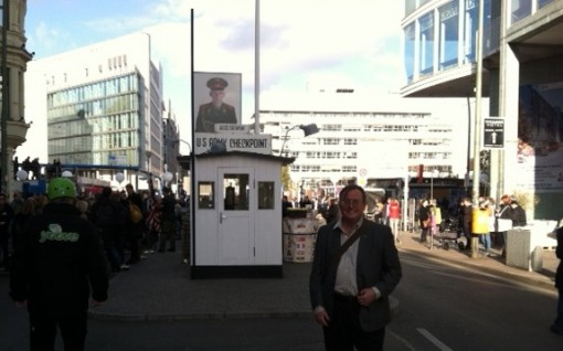 Standing at Checkpoint Charlie, the gateway through the Berlin Wall, 25 years after the Wall came down